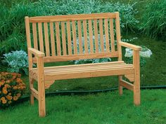 Take in your garden from the Pine Wood English Garden Bench from DutchCrafters Amish Furniture. Handcrafted from kiln-dried pine, this outdoor wooden bench features a slatted back and arm rests that can be customized with cup holders. #gardenbench #outdoor #seating