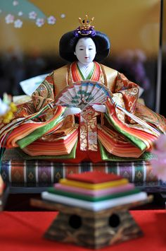 Japanese Hina doll. it looks Heian. the sleeves and layers look like armrests! O.o