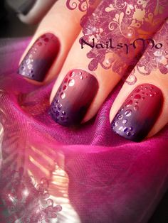 use purple and magenta gradient using wet sponge. Then apply one matte nail polish coat. Then take dotting tool and with ordinary top coat nail polish start to make some dots.