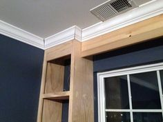 Built-in shelves around window. Can be done with pre-built furniture.