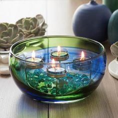Swirls of color are applied by hand for a stunning, one-of-a-kind creation. Artisan blown glass with metal tealight ring. Ask your PartyLite Consultant how you can enjoy the Spring Art Glass Multi-Tealight Holder in your home.