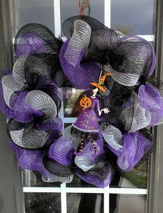 My first attempt at a Halloween wreath.  Used geo mesh fabric with a wire frame.  Working on coordinating garland next!