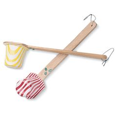 Shake, rattle, and roll with a set of these music makers.  What youll need Empty yogurt cups Hot-glue gun Popcorn kernels or dried beans Yardstick, wooden spoon o