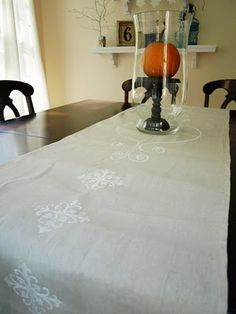Painted table runner out of canvas dropcloth.
