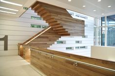 Cantilevered stair over 3 floors 78 risers. Fully timber clad with stainless steel handrail.