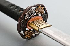 The Beauty of Ancient Samurai Sword / Tokyo Pic ~ katana with  ornately carved tsuba...beautiful!
