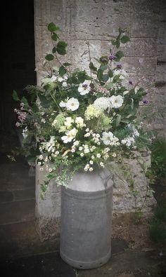 milk churn full of seasonal British flowers wedding flowers