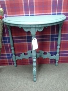 $85 - This is an early 1900's antique table. Sometimes referred to as a half moon. It fits flat against the wall and has an ornate bass and apron. Painted robins egg blue lightly distressed and waxed. 24 inches across, 12 inches deep. The table stands 24 inches tall. It can be seen in booth D 1 at Main Street Antique Mall 7260 East Main St ( E of Power Rd ) Mesa 85207  480 9241122open 7 days 10 till 530 Cash or charge