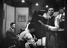 Frank Sinatra and musicians in a studio during a recording session at CBS.