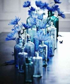 Love the idea of decorating with indigo? I'm sharing all the different ways you can bring this beautiful color into your home! Even if you're not normally a color lover, indigo can be the perfect Blue Wedding Centerpieces, Bottle Centerpieces, Flower Centerpieces, Blue Wedding Decorations, Winter Centerpieces, Wedding Vases, Deco Floral, Blue Bottle, Bottle Vase