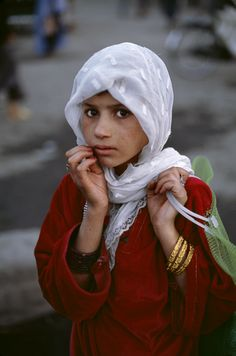 Afghanistan.  Her face is full of fear.  Is she going to school and worried about being killed because of it?