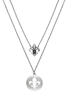 Rock 47® by Wrangler® Fleur de Lis Shadow Double String Necklace. This silver-tone 19 inch matinee length necklace has two chains each with a small fleur de lis pendant. The longer, 19 inch chain features a satin coin with a fleur de lis cut out, with its sculpted shadow fleur de lis hung from the shorter 18 inch chain above it.