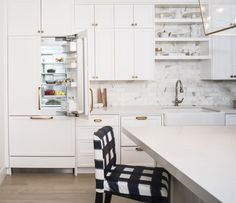 When closed, the integrated fridge becomes flush with the cabinetry. DCS's…
