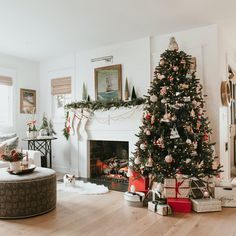 Founder of Katie Hammond, shows off her nature-inspired, whimsical, and classic holiday decor at her California home. Christmas Tree Lots, Christmas Village Houses, Colorful Christmas Tree, Christmas Decor, Eucalyptus Garland, Seeded Eucalyptus, Canopy Bed Frame, Miniature Christmas, Holiday Tables