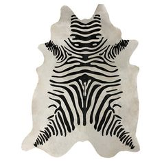 Anchor your living room seating group or define space in the den with this artfully hand-woven cowhide rug, featuring a zebra-print motif and organic silhoue...