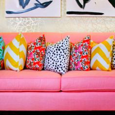 Pink couch and colorful pillows