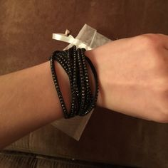 SALE !! Swarovski Slake black bracelet One day only !!!!!! This Slake bracelet is easy to combine with almost any outfit. It wraps comfortably around your wrist for a twisted look. The closure consists of two clear crystal buttons, allowing you to adjust the size (36/38 cm). Worn once ! No trades   Length 14 1/8 inch. Swarovski Jewelry Bracelets