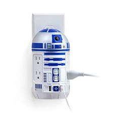 This Star Wars R2-D2 AC Power Strip plugs into a Type B socket (US Standard) and in exchange provides 4 Type B sockets (US Standard) and 2 USB ports (2.1A and 1.0A).
