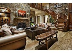 Loving the different types of wood, chunky stone & leather + other cozy accents in this beautiful #LivingRoom