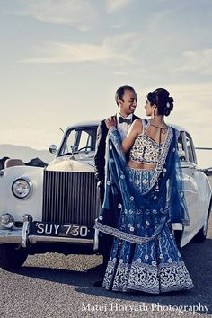 Before heading into their fabulous wedding reception, this Indian bride and groom take a moment to pose for beautiful portraits!
