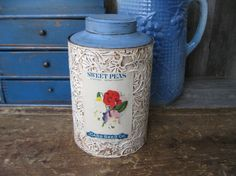 I painted this old tea tin and added an antique seed pack label to the front
