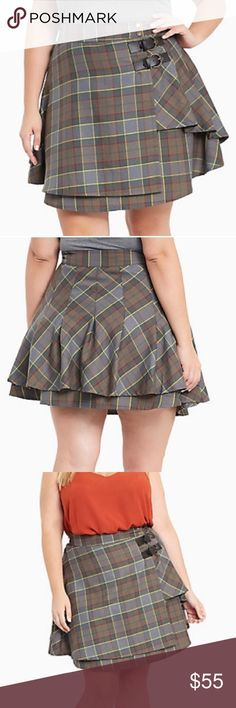 Torrid outlander Fraser tartan plaid skirt Torrid exclusive outlander Fraser tartan plaid skirt. Completely sold out. Wore just one time. It does run small so keep that in mind it fits more like a 24. A cuter upgrade from Jamie's kilts, this tartan plaid mini skirt would have us traveling back in time too. The red, yellow, grey and green plaid layers up with a faux wrap front and keeps it together with Celtic inspired. Amazing condition torrid Skirts