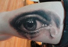 Eye Tattoo in black White and Grey Shading is the Clever bit this is an amazing Tattoo look at the Iris and the 3D effect of the Tear drops its a Tattoo not a Photo