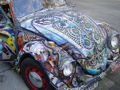 Glass Quilt Art Car by Ron Dolce. http://www.artcar.blogspot.com/2007/12/glass-quilt-mosaic-vw-art-car.html