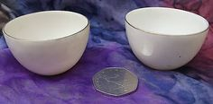 Two of plain white vintage china miniature bowls Just 2 inches across and one-and-a-quarter inches tall Although they are very similar they are not