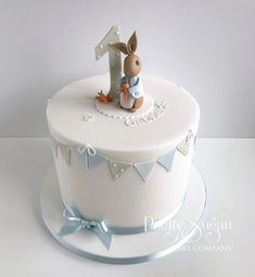 Browse through the different cakes we create here at The Pretty Sugar Cake Company, from Wedding Cakes & Wedding Favours to Celebration Cakes, to Cupcakes & Cookies. Peter Rabbit Cake, Peter Rabbit Birthday, Peter Rabbit Party, 1st Birthday Cake For Girls, Baby Birthday Cakes, 1st Birthday Cakes, Beatrix Potter Cake, Christening Cake Boy, Sugar Cake