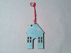 Festive Ornament House, Blue with Red String. Featured in 2014's November issue of HGTV™ magazine.