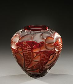 «Courlis», an amber coloured, blown-moulded glass vase. Signed «R.Lalique-France». Model created in 1931.