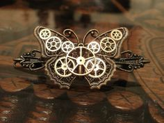 Hey, I found this really awesome Etsy listing at http://www.etsy.com/listing/79083992/steampunk-clockwork-butterfly-barrette