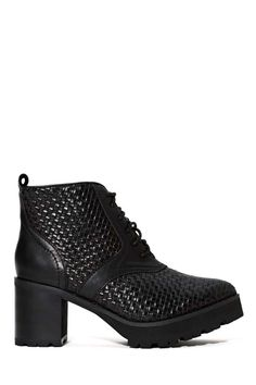 Get your slick on in the newest from Jeffrey Campbell-- it has a woven leather shell design, lace-up detail, and lug sole.