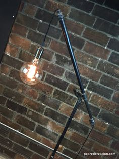 Industrial Floor Lamp Articulating Pulley di newwineoldbottles