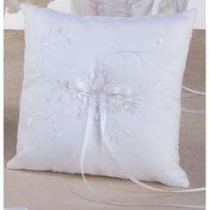 Tessa Ring Pillow.  I LOVE the flower accents on this one!