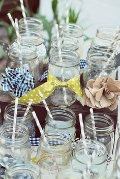 Mason jars as glassses for a summertime party in the back yard.... of course with a little dressing up from the ribbon basket of odds and ends. These jars/glasses could make a lot of people happy, happy, happy!