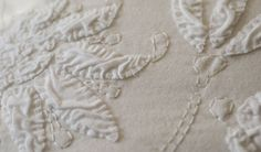 detail from Relief Applique Chair pillow DIY kit, Alabama Chanin   100% organic cotton with Angie's Fall Stencil in Relief Applique