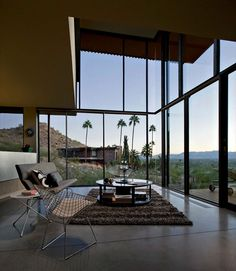 Lovely two story high windows compliment this modern design.  The Modern Jarson Residence in Arizona  http://freshome.com/2012/02/28/embacing-peacefulness-the-modern-jarson-residence-in-arizona/