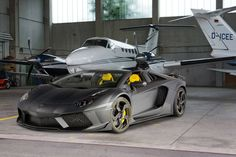 Mansory Lamborghini Carbonado Roadster. Wow.... So badass , it can carry this plane, like a boeing carrys the shuttle! ...lol nah!