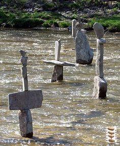 Statues in Humber River, Toronto, Ontario, Canada, 2013, photograph by Istvan Banyai.
