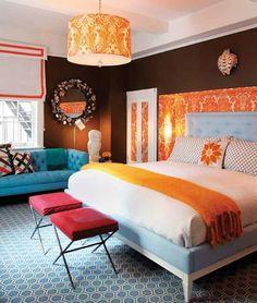 Bright Orange Bedroom...but reversed colors. Orange on the walks, white spread, brown bedding