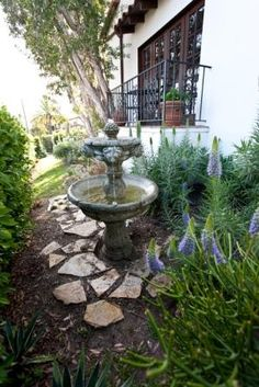 landscaping around fountains   Provides water for birds