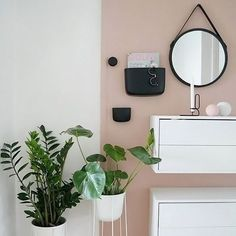 Love this beautiful home of @itskjakobsen Menu Plant pot, stand and Normann Copenhagen Pocket wall organizer are all available in our online store. . #livingroom #livingroomdecor #nordichome #nordicinspiration