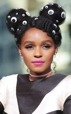 Janelle Monae from The Big Picture: Today's Hot Pics Goggly-eyed! The singer rocks a unique hairstyle while visiting the New York AOL HQ to discuss the film Hidden Figures.