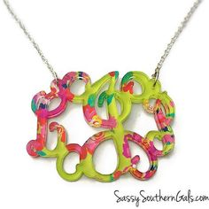"Wonderfully colorful and so unique, our monogram pendant necklace comes in your choice of Lilly Pulitzer-inspired patterned acrylics as well as 19 gorgeous solid colors. So lightweight, the size of the pendant can vary from 1"" to 1.7"" with two monogram styles to choose from – a one, two or three letter vine design or a circle monogram design. Comes on an adjustable 16″ to 19″ sterling silver chain or you can upgrade to a same length 16K gold plated chain or a 24"" silver plated chain. Makes a…"
