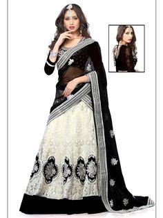 Auspicious look #Net #Lehenga in off white, black color is embellished with resham, zari, kundan, applique work. Item Code : GKRI382B http://www.bharatplaza.com/women/lehengas.html