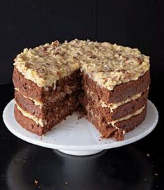 German Chocolate Cake  INGREDIENTS  3 cups sugar1 ¾ cups unsalted butter, softened2 ½ tsp. vanilla extract8 large egg yolks1 12-oz. can evaporated milk1 ½ cups roughly chopped pecans1 7-oz. package sweetened shredded coconut4 oz. German's Sweet Chocolate, chopped2 oz. unsweetened chocolate, chopped2 cups flour1 tsp. baking soda¼ tsp. kosher salt1 cup buttermilk4 large egg whites  INSTRUCTIONS  1. Combine 1 ½ cups sugar, ¾ cup butter, 1 ½ tsp. vanilla, 4 egg yolks, and evaporated milk in a…