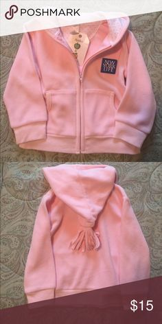 Baby girls' New York life fleece hoodie This hoodie is so soft, it is s pale pink and has pink polka dot detail in the hoodie with a pom pom! Super cute and still has the tag on it, never worn. New York life Jackets & Coats