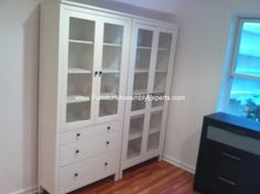 ikea hemnes cabinet with glass door assembled in vienna va by Furniture assembly experts LLC - call